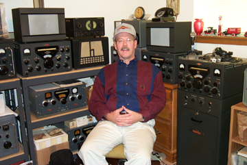 Picture of Charlie with various radios in his CQ room. The CQ room got it's name from our daughter when she was about 2 or 3 years ago. She kept hearing him call CQ, CQ, CQ.